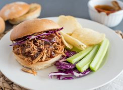 Instant Pot Pulled Pork sandwich, with cabbage, celery, and potato chips
