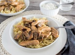 Instant Pot / Pressure Cooker Pork Stroganoff, dished up over egg noodles