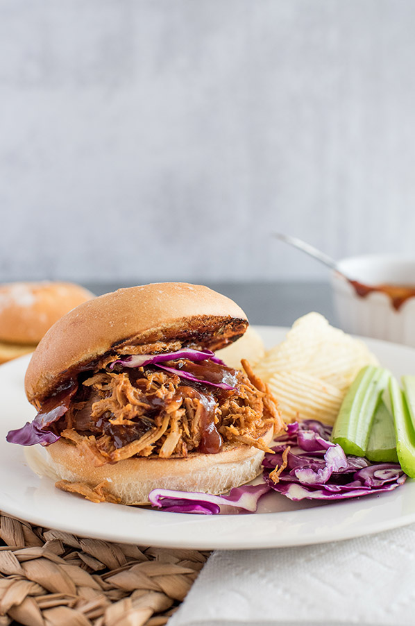Pressure Cooker Easy Pulled Pork sandwich, with cabbage, celery, and potato chips