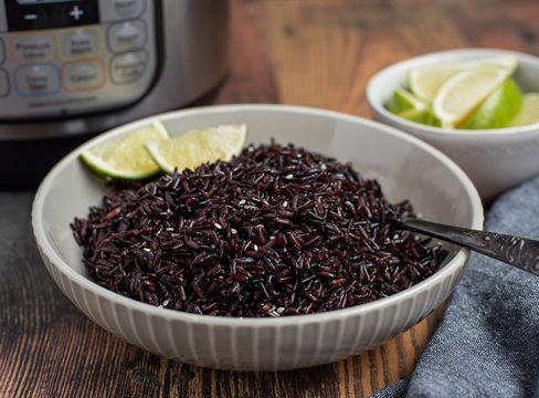 Pressure Cooker Black Rice prepared with limes and an Instant Pot in the background