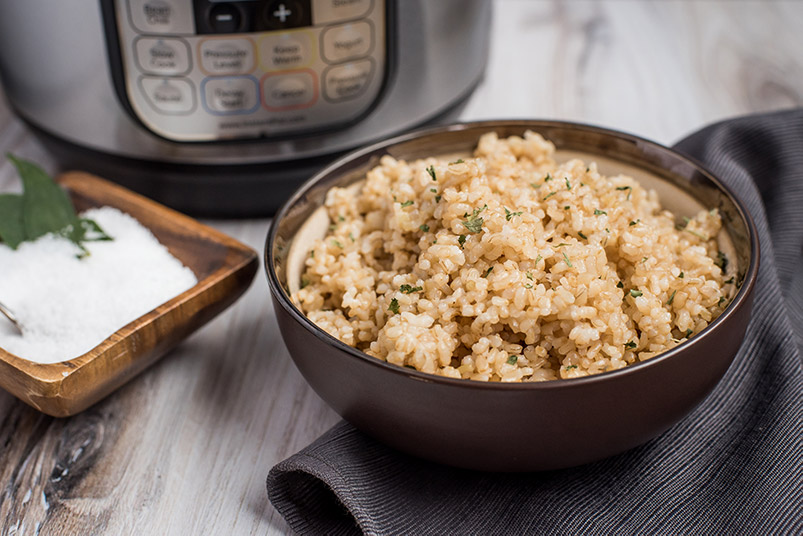 Pressure Cooker Brown Rice prepared with a dish of salt and an Instant Pot in the background