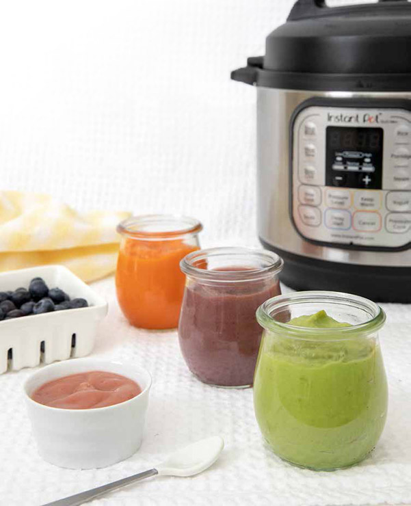 Four flavors of Baby Food Puree cooked in the Instant Pot—strawberry apple, carrot, banana blueberry pear, sweet pea and avocado purees