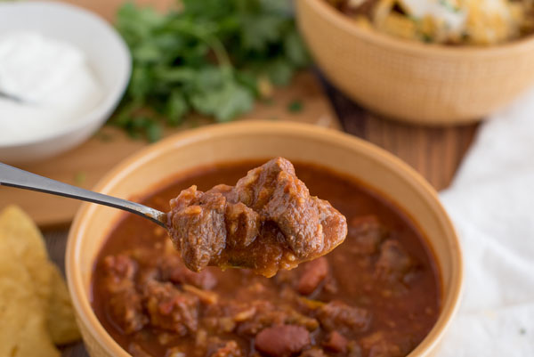 A spoonful of Instant Pot Chili with Beef and Kidney Beans, prepared in the electric pressure cooker