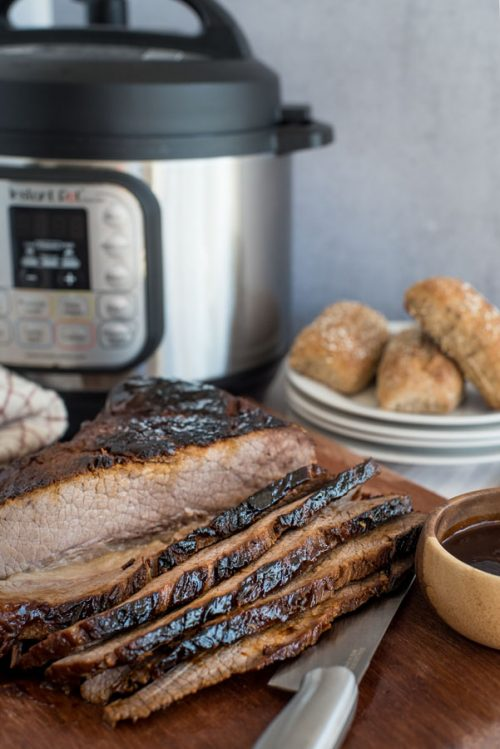 BBQ beef brisket sliced in front of an Instant Pot.