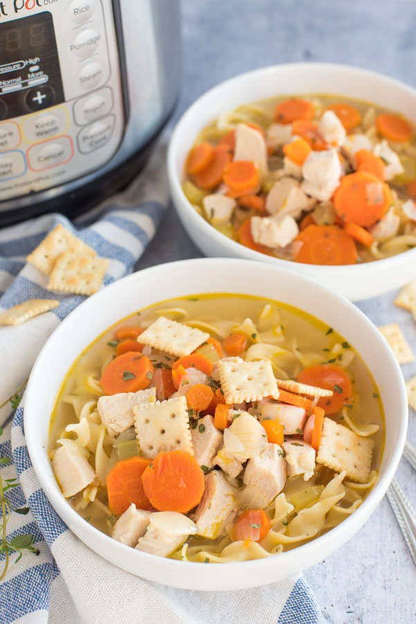 pressure cooker chicken soup recipe served in front of an Instant Pot