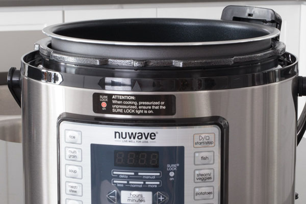Nutri-Pot NuWave Pressure Cooker with the lid removed from the hinge.
