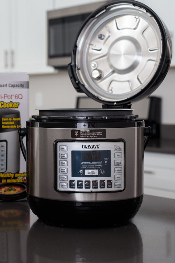 Nutri Pot NuWave Pressure Cooker with lid opened on a hinge.