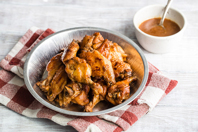 Instant Pot / pressure cooker teriyaki chicken wings placed in a tin and ready to serve.