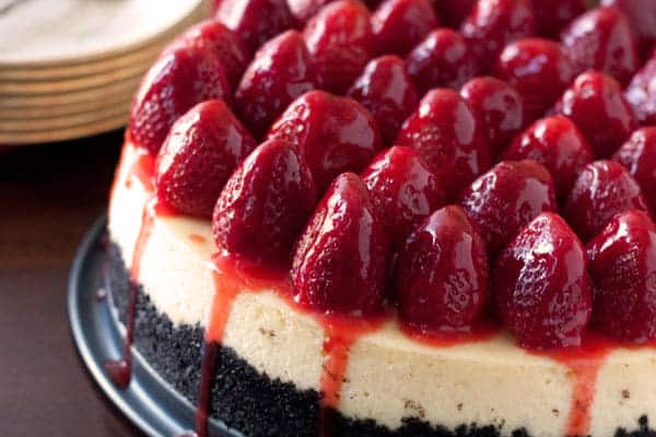 Strawberry Cheesecake from barbara bakes, ready to serve with whole strawberries topping the entire cheesecake