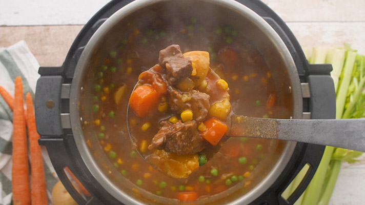 Beef stew recipe for an Instant Pot scooped out and ready to serve.