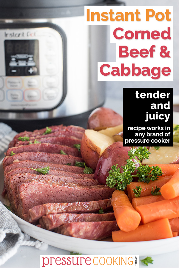 A white plate full of Pressure Cooker / Instant Pot Corned Beef and Cabbage, carrots, and potatoes, with an Instant pot featured in the background via @PressureCook2da