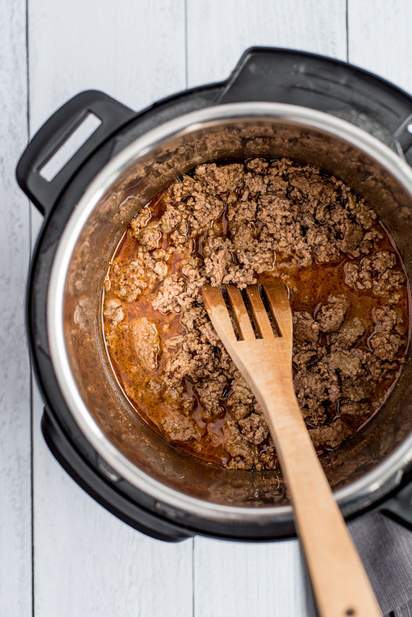 Overhead shot of ground beef cooked in an Instant Pot with all the spices.