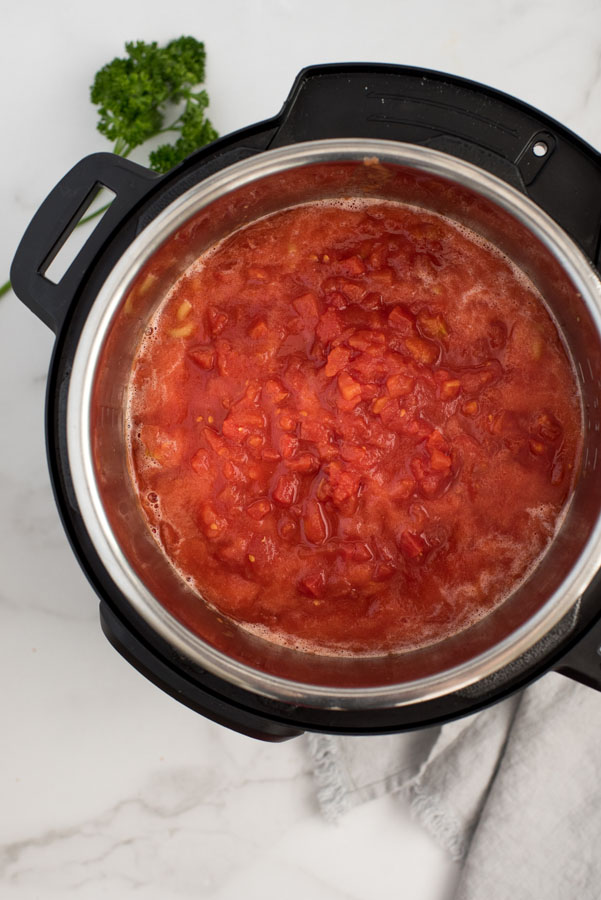 cooking tomato sauce in an instant pot to make american chop suey