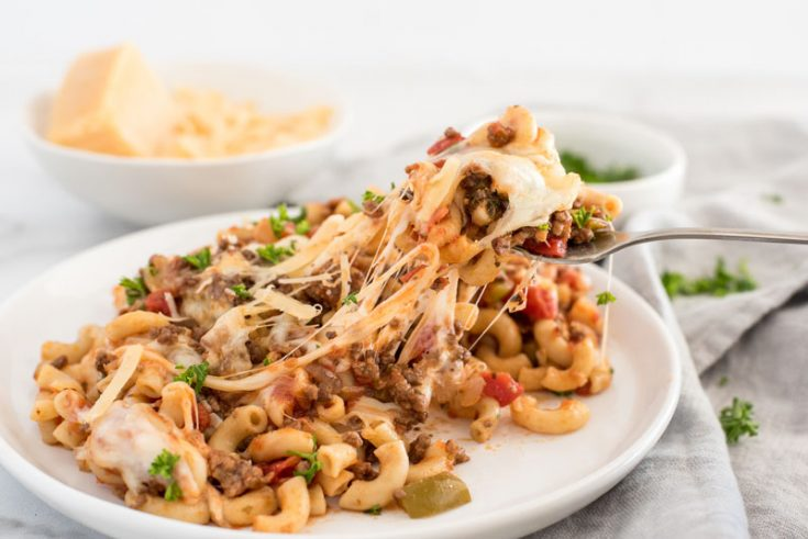 Instant pot american chop suey/beefaroni with melted cheese on a white dinner plate