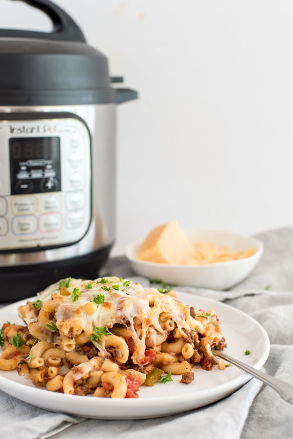 pressure cooker american chop suey / beefaroni on a table in front of an instant pot