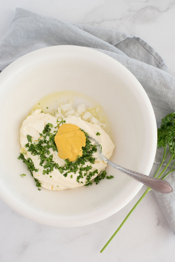 ingredients for quick pressure cooker potato salad: mayonnaise, dijon mustard, fresh herbs