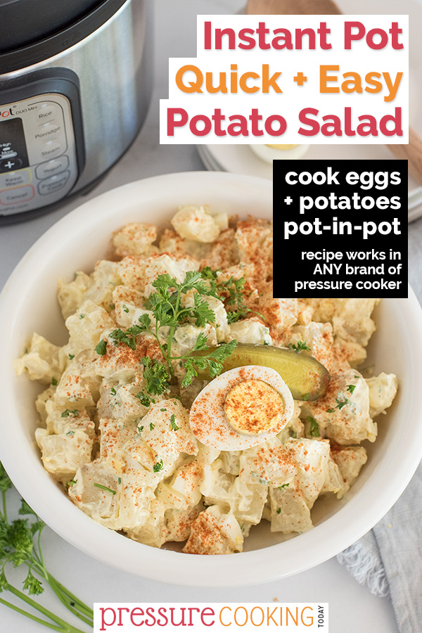 Overhead shot of a bowl of potato salad garnished with parsley and a sliced pickle placed in front of an Instant Pot.