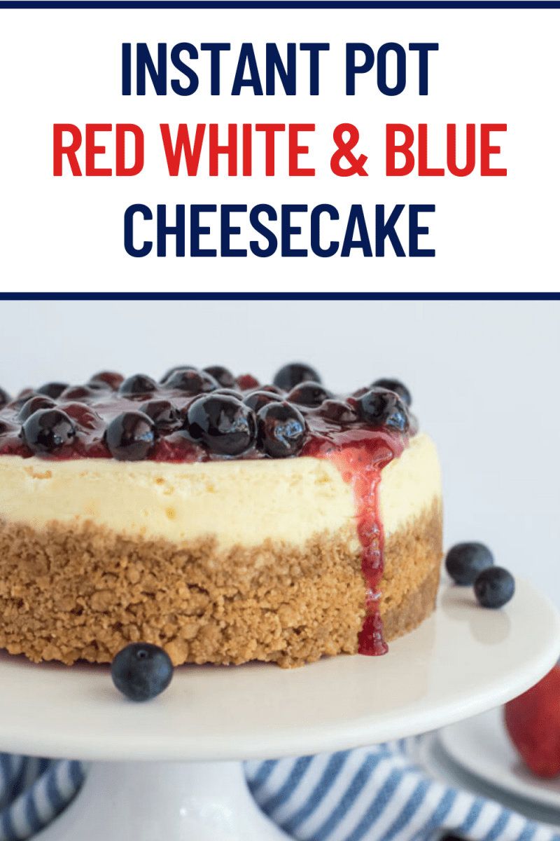 titled photo: Red White & Blue Cheesecake - cheesecake on a white cake plate, topped with blueberry and strawberry compote