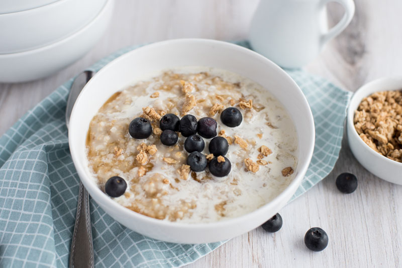 pressure cooker oatmeal with blueberries in a white cereal bowl