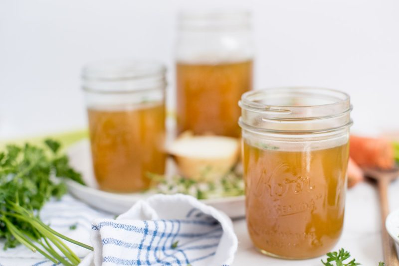 three mason jars with instant pot chicken stock