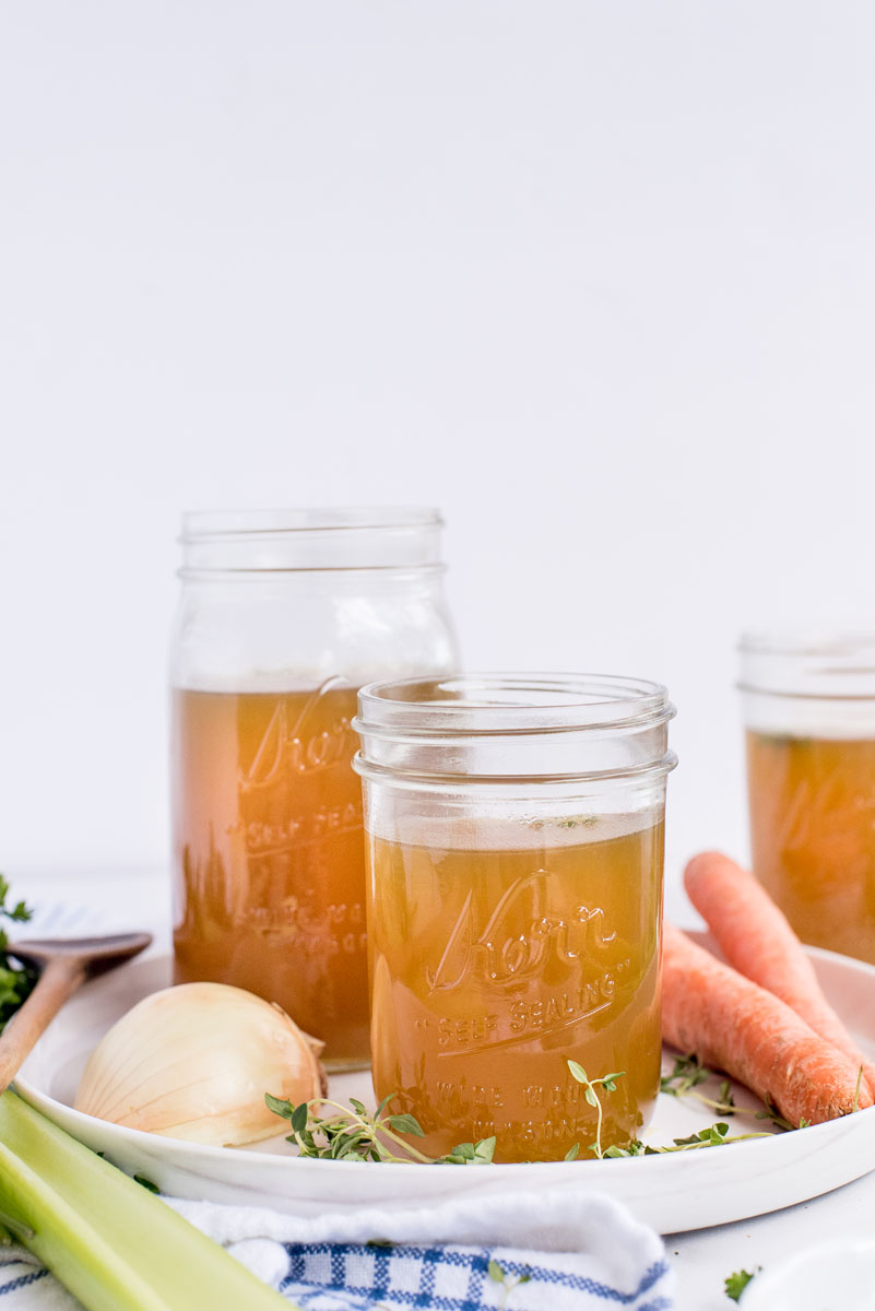 three mason jars with chicken stock