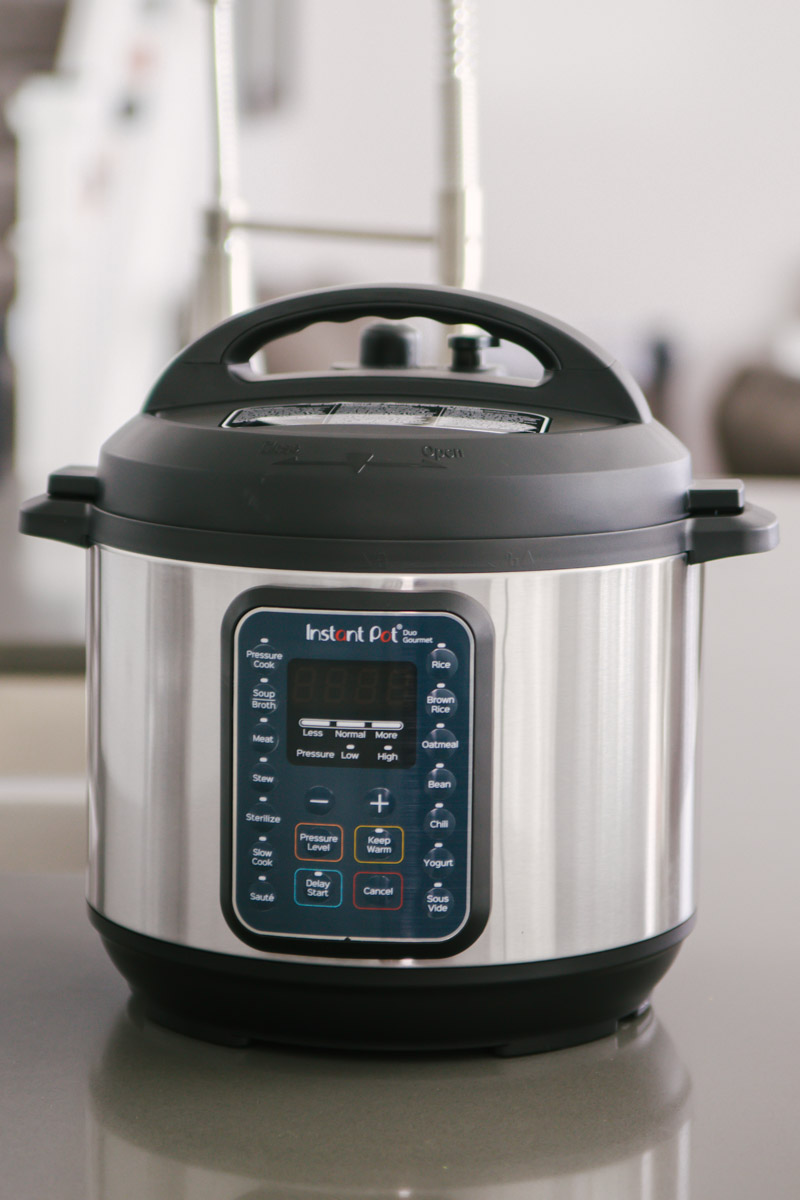 direct front close up of the Instant Pot Duo Gourmet on a gray countertop