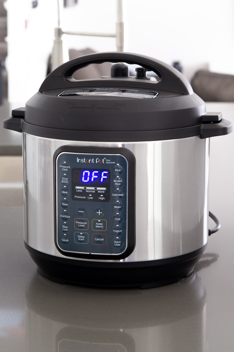 "direct front shot of the Instant Pot Duo Gourmet with the blue light LED screen reading ""OFF"""