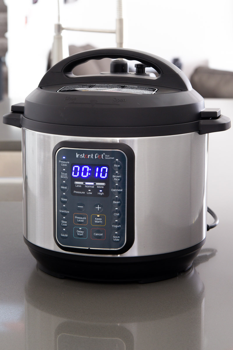 direct front shot of the Instant Pot Duo Gourmet with the Pressure Cook button selected and 10 minutes on the timer