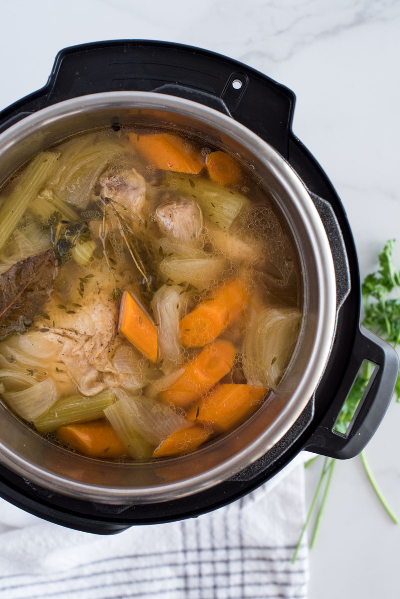 Overhead shot of turkey stock cooked in an Instant Pot that is ready to be strained.