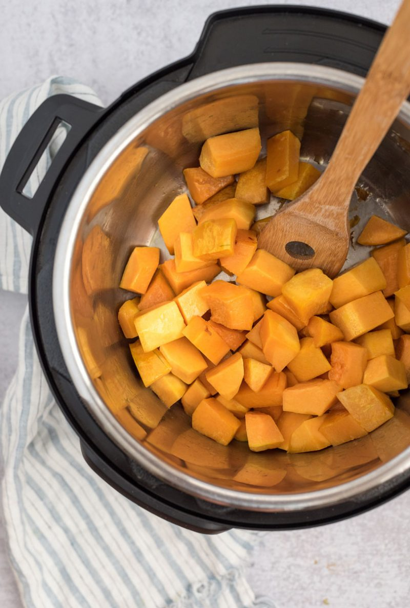an overhead shot showing cubed butternut squash in the bottom of an Instant Pot