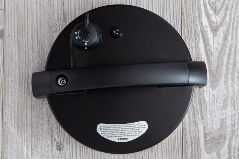 The top of the Zavor LUX pressure cooker lid with a manual pressure release valve.