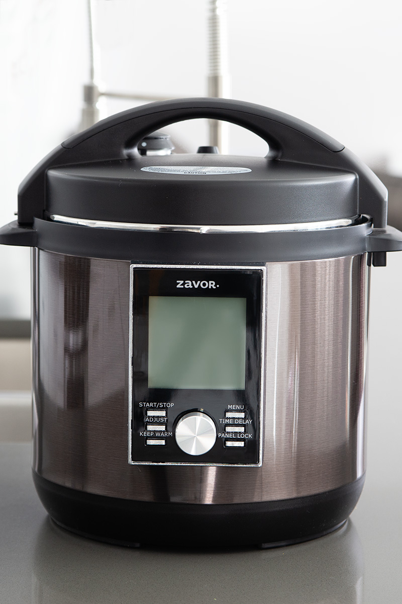 Black stainless steel Zavor LUX placed on a kicken counter.
