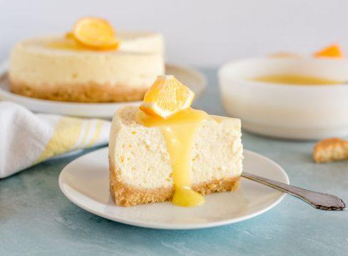 slice of lemon cheesecake with lemon curd