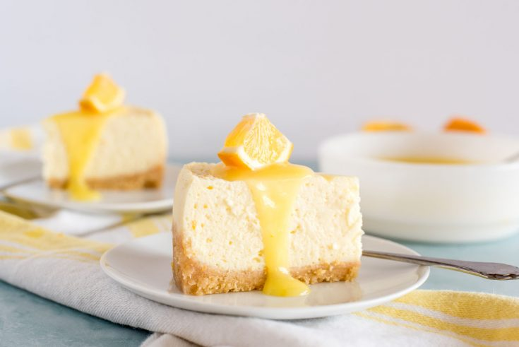 slices of instant pot lemon cheesecake with lemon curd on top