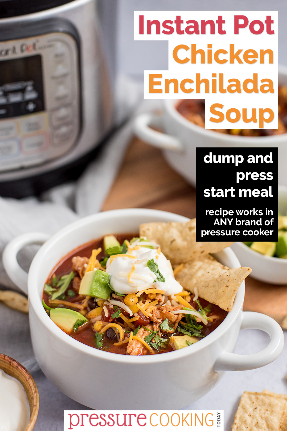 """Pinterest image promoting Instant Pot Chicken Enchilada Soup with a black text box that reads """"dump and press start meal, recipe works in any brand of pressure cooker"""" overlaid on a photo with a white soup bowl loaded with red soup, topped with avocado, shredded cheese, sour cream, cilantro, and garnished with tortilla strips, with an Instant Pot visible in the upper left background via @PressureCook2da"""