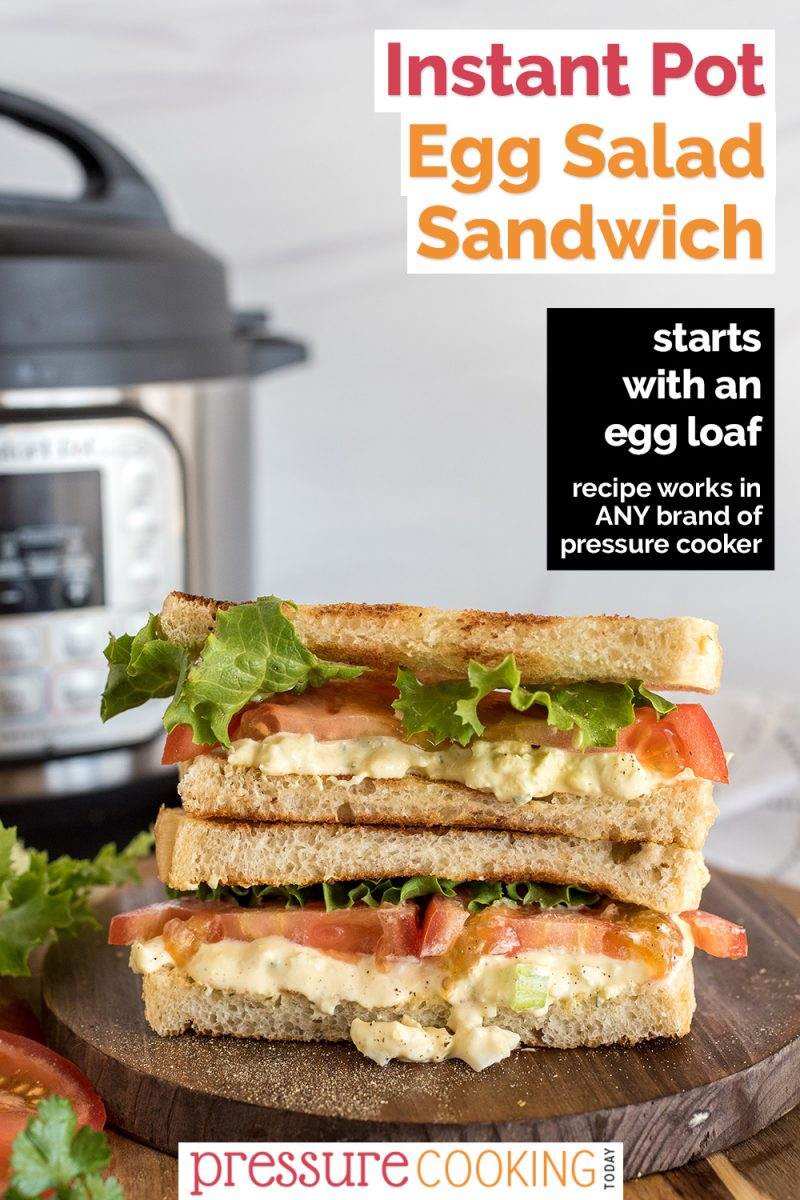 """Pinterest Image that reads """"Instant Pot Egg Salad Sandwiches: Starts with an Egg Loaf"""" with a straight-on picture of cut egg salad sandwiches with toasted bread, green leaf lettuce, tomatoes, and egg salad, layered with two halves on top of each other, with an Instant Pot in the background"""