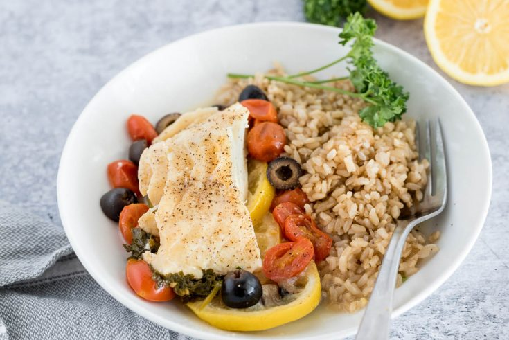 close up on a plate with mediterranean fish en papillote