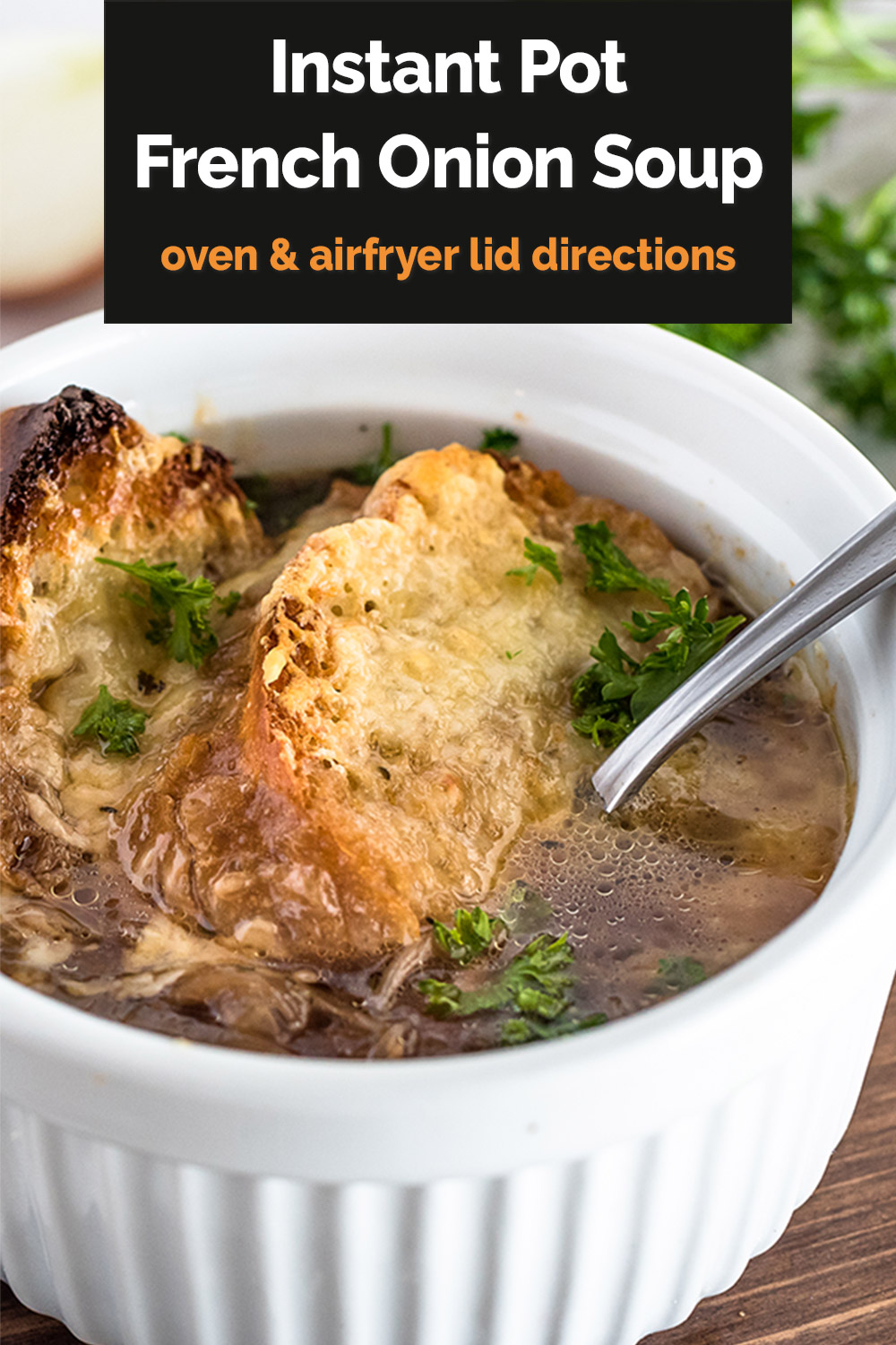 """Pinterest Image that reads """"Instant Pot French Onion Soup: oven and air fryer lid direction"""" in a black text box overlaid on a close-up vertical image of French Onion Soup with crusty browned baguettes and melted cheese in a white ramekin via @PressureCook2da"""