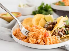 plate of instant pot spanish rice with tacos