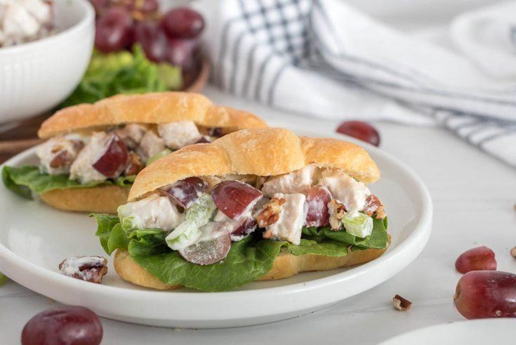 two chicken salad sandwiches on croissants