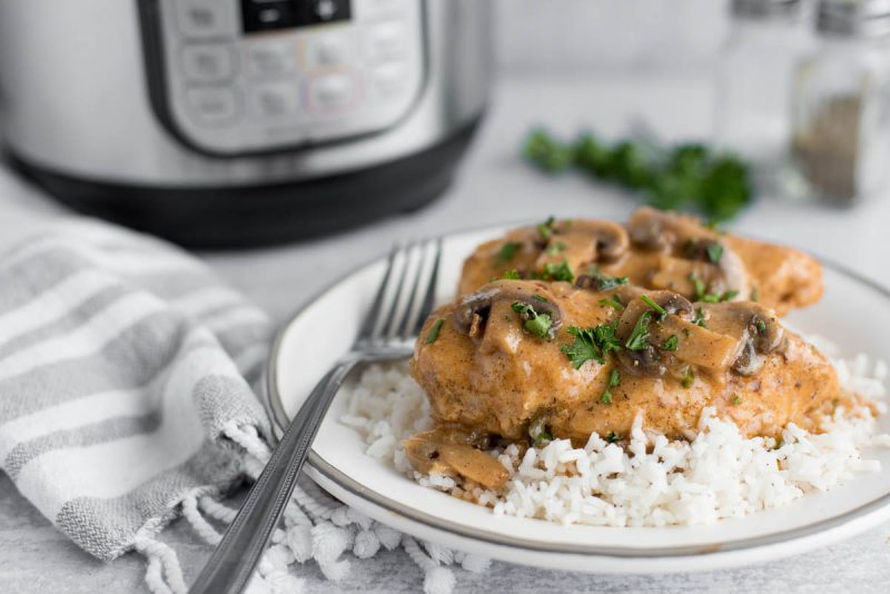 chicken in mushroom sauce in front of an instant pot