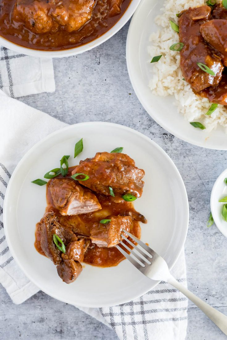 white plate with country style pork ribs in gravy