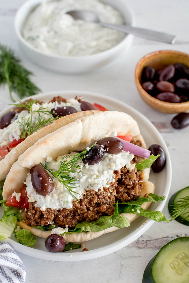 close up of pitas with greek beef tacos and yogurt sauce