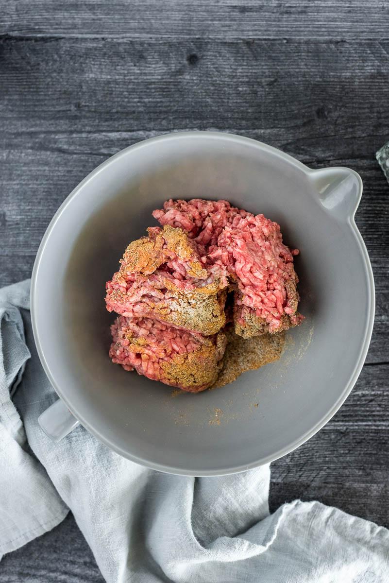 mixing bowl with hamburger meat and seasonings