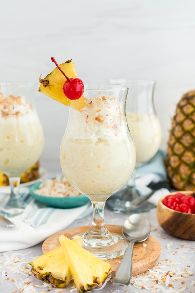 two glasses of coconut rice pudding with fresh pineapple