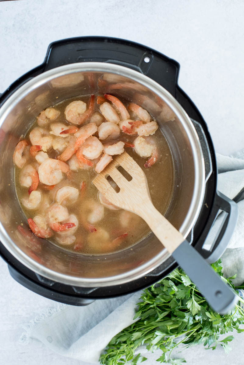 overhead of an instant pot cooking pink shrimp