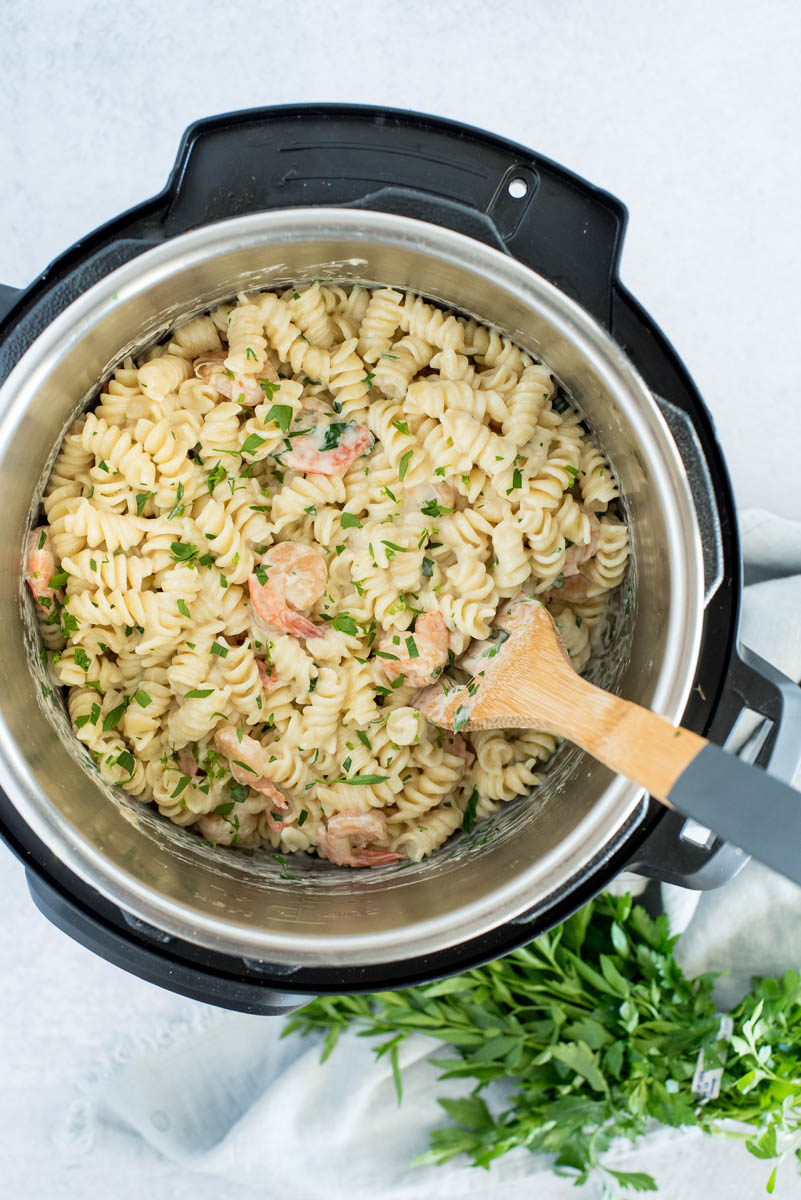 overhead of an instant pot with shrimp alfredo pasta