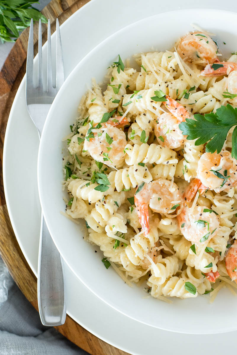 overehad of a white bowl with shrimp alfredo pasta