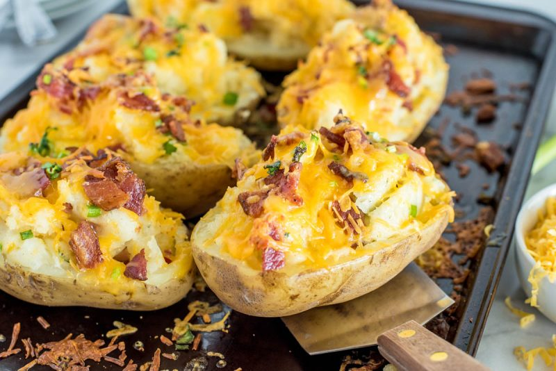 twice baked ranch poatoes on a baking sheet with a spatula under