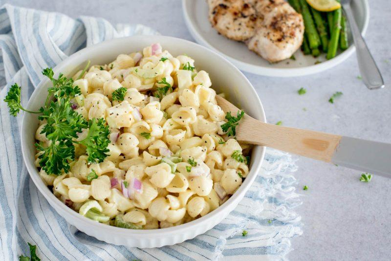 white bowl of amish potato and pasta salad
